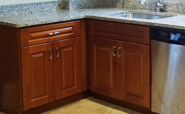 red-maple-cabinets-and-moon-white-granite-2
