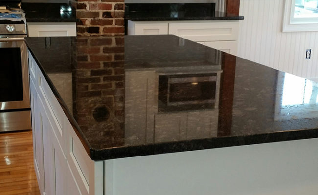 White Shaker Cabinets And Steel Gray Granite 1